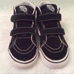 Vans black and white high tops with straps. Nice!